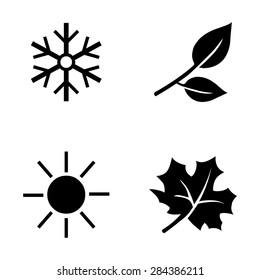 Vector Set of  Black Seasons Icons. Winter, Spring, Summer, Autumn.