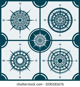 Vector set of blue isolated compass roses. Collection of different wind roses for graphic design. Vector illustration.