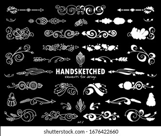 Vector set of calligraphic elements for design drawing in chalkboard style. Hand drawn cute arrows, indexes, dividers, flowers, ear of wheat elements. Ornate and silhouette options