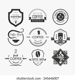 Vector set of coffee shop logos, restaurant or bar logotype design elements with mugs and beans. Ribbons, circle shapes, lables, insignias with coffee related elements.