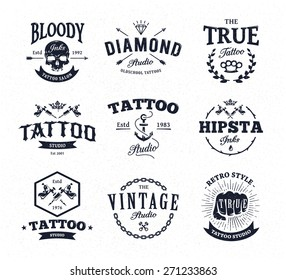 Vector set of cool tattoo studio logo templates on white background. Retro styled trendy vector emblems.