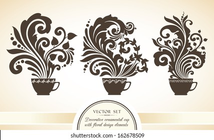 Vector set of decorative ornamental cups with floral design elements