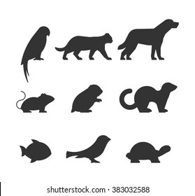 Vector set of figures of pets. Silhouettes parrot, cat, dog, mouse, hamster, ferret, fish, canary and turtle.