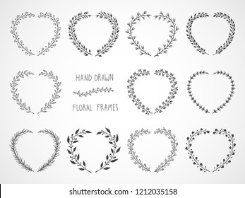 Vector set of floral hand drawn frames in the shape of a heart.