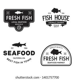 Vector set of fresh fish labels, logo, badges and design elements. Great Restaurant and Seafood Emblems. Vintage illustration.
