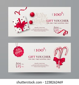 Vector set of gift vouchers with candy canes, gift box, bow, ribbon and christmas toy. Festive template for design of holiday certificate or card with lettering Merry Christmas. Isolated on background