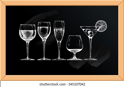 Vector set of glasses goblets on chalkboard background.