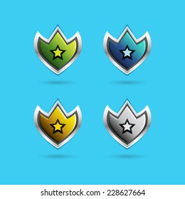 Vector set of glossy shield icons in green, blue, silver and gold, with shadows. Best for web or game design. GUI design for social game.
