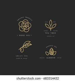 Vector set of golden packaging design templates and emblems - beauty and cosmetics oils - argan, rose, almond and tea tree. Logos in trendy linear style