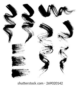 Vector set of grunge brush strokes. Black mascara brush strokes set. Black paint spots vector set