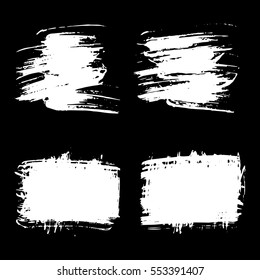 Vector set of grunge brush strokes. White vector brush in a black background. Strokes collection. Grunge stains. Set of brushes design elements, hand drawn with ink.