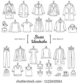 Vector set with hand drawn isolated doodles of basic wardrobe on white background. Fashion sketches
