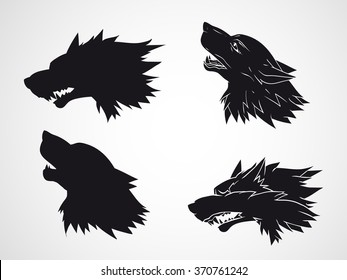 Vector set of hand drawn wolf heads. Black silhouette.