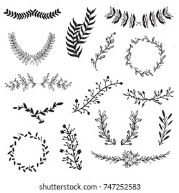 Vector set of handdrawn doodle frames and borders. Handdrawn elements, flowers, branches, swashes and flourishes.