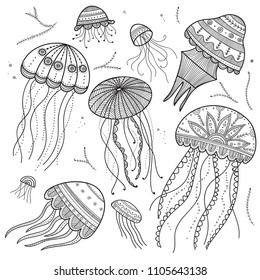 Vector set of jellyfishes in ethnic boho style with zen doodle and tangle elements. Can be used as coloring page, template, etc.