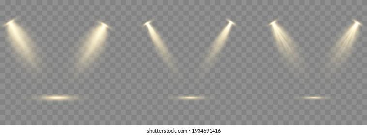 Vector set of light. Golden light source, studio lighting, walls, png. Light beams, light effect.