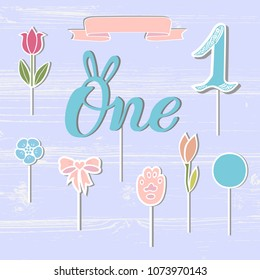 Vector set with One, flowers, paw, ribbon. One handwritten lettering as patch, stick cake toppers, laser cut plastic, wooden toppers. Props for First Year Baby Anniversary, Birthday party.