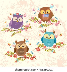 vector set of owls. beautiful birds on flowering branches. You can be used to scrapbooking, packaging, ornaments, stickers, textiles. very cute and good characters