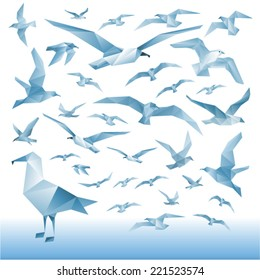 Vector set - seagulls silhouettes (flying birds) Illustration of a many triangles.