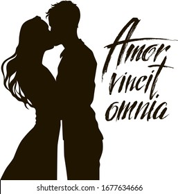 """Vector set. Silhouette of a kissing  couple . Young man and woman. Black on white. Quote """"Love wins all"""" in Latin. Romantic design for postcards, posters for weddings, Valentine's day"""