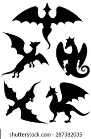 Vector set of silhouettes of dragons stencil
