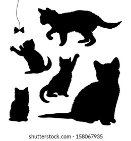 Vector set of silhouettes of playing kittens, cats isolated on white background