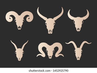 Vector set of six hand drawn gold silhouettes skulls of horned animals: wild buffalo, bull, goat and ram on black background. For you design, print, tattoo or magic craft.