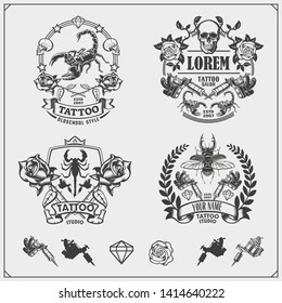 Vector set of tattoo salon labels, badges and design elements. Tattoo studio emblems with professional equipment, scorpion, beetle and skull. Print design for t-shirt.