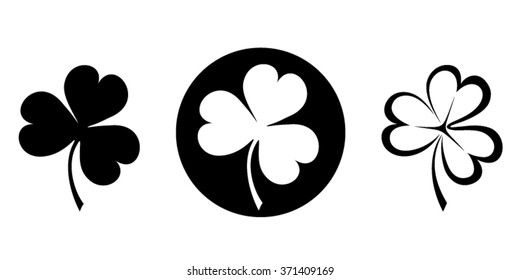 Vector set of three black silhouettes of clovers (shamrock).