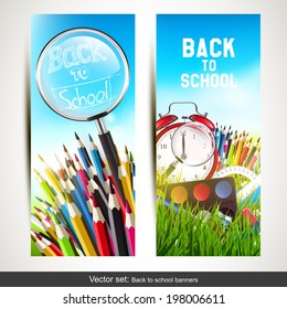 Vector set of two school banners with school supplies in the grass