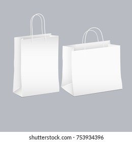 Vector set of two white empty shopping paper bag. Graphic mockups for design