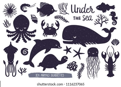 Vector set of underwater animals silhouettes: octopus, whale, turtle, dolpin, jellyfish, crab, lobster, seahorse, squid, clownfish, butterflyfish, seaplants and corals.