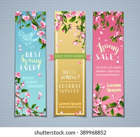 Vector set of vertical spring banners. Pink cherry blossoms, leaves and birds on tree branches. Hello spring! Goodbye winter! Best spring ever! Spring sale. There is place for your text.