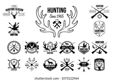 Vector set of vintage emblems for hunting club. Original monochrome labels with silhouettes of dogs, guns/rifles, goose and heads of deer