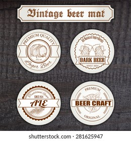 vector set of vintage hand drawn beer mat with logo on wooden desk