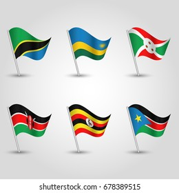 vector set of waving flags uganda, rwanda, burundi, kenya, tanzania and south sudan on silver pole - icon states of east african community