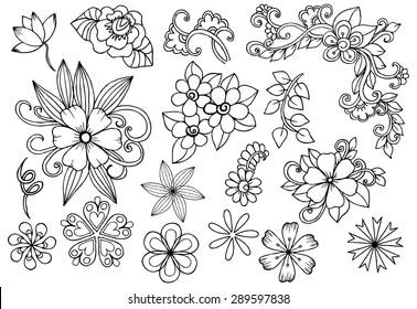 Vector set of white and black flowers. Doodle floral design elements.