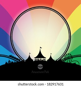 Vector silhouette of amusement park with rainbow background