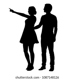 Vector silhouette of boy and girl standing together and pointing finger - isolated on white background