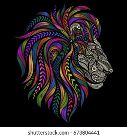 Vector silhouette of a lion from beautiful patterns with a color mane on a black background