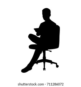 Vector silhouette of a sitting businessman on chair. Isolated vector on  white background.