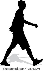 Vector silhouette of the walking man with a bag