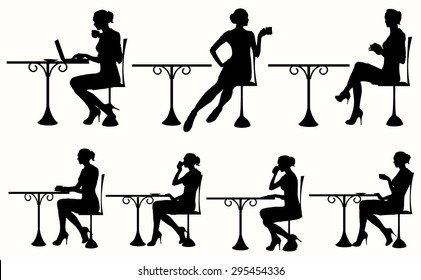 Vector silhouette of Woman Sitting At The Table. Woman having coffee / tea and using a laptop / book