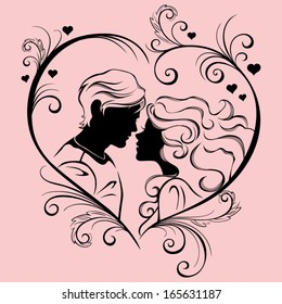 Vector silhouette of a young couple in the heart