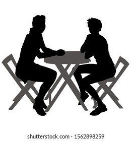 Vector silhouettes of two young women in shorts and a short dress. 2 girls sit at a table in the summer outdoors. Side view of the girls.