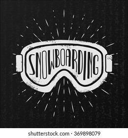 Vector snowboarding label. Goggles and typography on vintage cardboard background.