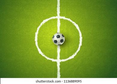 Vector soccer ball on green field. Soccer ball on green grass. Football 2018.