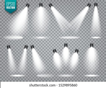 Vector spotlight set. Bright light beam. Transparent realistic effect. Stage lighting. Illuminated studio spotlights.