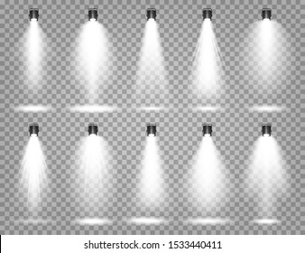 Vector spotlight set. Bright light beam. Transparent realistic effect. Stage lighting. Illuminated studio spotlights.