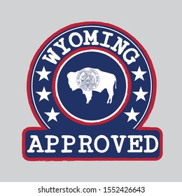 Vector Stamp of Approved logo with Wyoming Flag in the round shape on the center. The states of America. Grunge Rubber Texture Stamp of Approved from Wyoming.